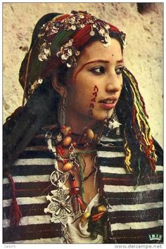 Africa | Young Berber Woman, Morocco | This is a postcard image, no photographer details were provided.