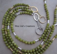 Olive green jade lanyards use for an id badge keys transportation