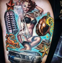 Got this done around 6 months ago. It's still looks like new. I wanted to incorporate as many of the things I love in one tattoo. I have a huge obsession with Ford Mustangs, the Shelby being my favourite. I love music, but also the 50's era, so wanted a gramophone and mic. The Pin-Up is very sultry, which is very much like my personality. She also bares a tattoo on her thigh, which is the crest of my football club Tottenham Hotspur. The stars were an idea my tattooist had to tie in the…