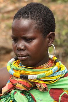 Africa | Portrait of a young woman wearing beaded necklaces, Tepeth, Uganda. | © Watler Callens #beads