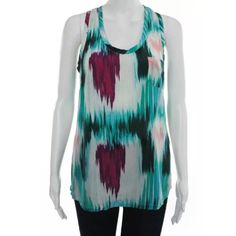 Joie Alicia Ikat Silk Tank Top MORE PHOTOS COMING! Joie's signature Alicia racerback silk top in a gorgeous watercolor ikat print! Features a patch bust pocket, scoop neck, racerback style.  Amazing, like new condition! No stains, marks, pulls, etc. Purchased for $140 from Anthropologie. No trades! Open to reasonable offers.  Size S  * Fabrication: Woven silk. * 100% silk. * Dry clean. * Imported. Joie Tops Tank Tops
