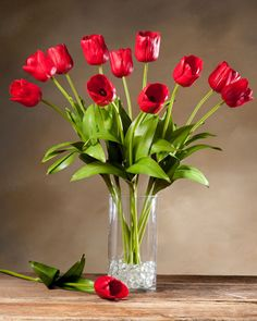 Add Effortless Elegance with High-Quality Tulip Silk Flower Stem. Shop at Petals Risk-Free with our Satisfaction Guarantee! Flower Arrangements Simple, Silk Floral Arrangements, Vase Arrangements, Fake Flowers, Exotic Flowers, Silk Flowers, Beautiful Flowers, Tulips In Vase, Red Tulips