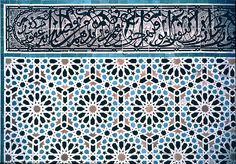 Image MOR 0308 featuring decorated area from the Attarine Medersa, in Fez, Morocco, showing Geometric Pattern and Calligraphy using ceramic tiles, mosaic or pottery.