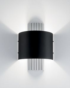 Soho is an Art Deco inspired piece featuring deep vertical ribbing in Polished Aluminium and curved metal shades in Satin Black. The wall light emits an attractive spill of up and down light to create an ambient light effect suited to both guestroom and public area spaces.