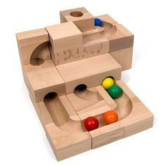 """Amazing """"marble run"""" toy sets allow kids to use interchangeable pieces to build complex Rube Goldberg like systems. Wooden Toys For Toddlers, Toddler Toys, Toys For Boys, Gifts For Boys, Girls Toys, Wooden Marble Run, Marble Toys, Diy Cadeau Noel, Wooden Wagon"""