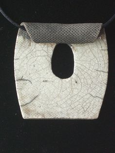 Raku Pendant - good idea to roll top edge. could also add wavy shape to rest of it.