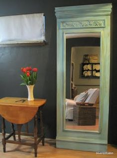 just a regular mirror glued to plywood and then odd end assorted wood elements added. What a great way to make something inexpensive look incredibly expensive & fancy-pantsy.