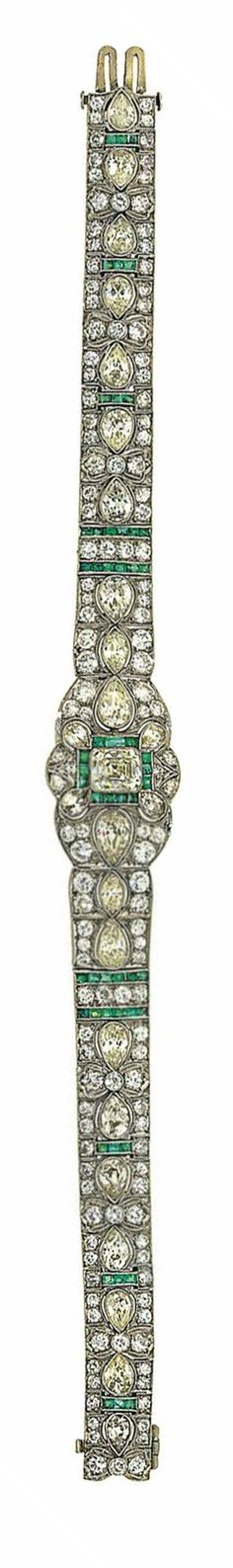 A diamond and emerald bracelet   Composed of articulated tapering panels set with pear-shaped and brilliant-cut diamonds and calibré-cut emeralds, the central section set with a rectangular cut-cornered diamond in a calibré-cut emerald, pear-shaped and brilliant-cut diamond surround, 18.0cm long