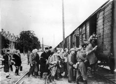 Warsaw, Poland, Polish POWs, probably Jews, being loaded on a train by Ukrainian militiamen.