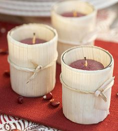 Use tamale-making husks to dress up candles for your Thanksgiving table. More easy Thanksgiving crafts: http://www.bhg.com/thanksgiving/crafts/easy-thanksgiving-handcrafts/?socsrc=bhgpin103012tamaleleafcandles