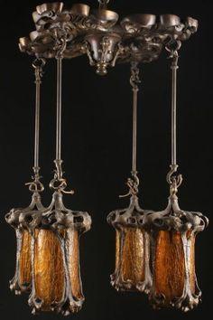 AN ART NOUVEAU BRONZE AND AMBER GLASS CHANDELIER : Lot 715