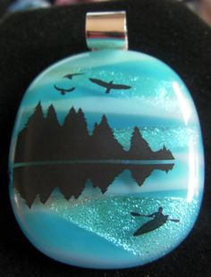Hey, I found this really awesome Etsy listing at http://www.etsy.com/listing/156689350/mountain-lake-with-kayak-and-birds-fused