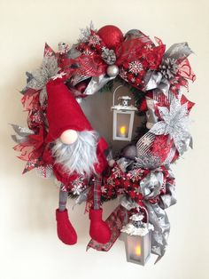 Christmas Gnome. The wreath is around 50 cm. Base is artificial greenery. Added ribbon strips, bow. Two decorated lanterns, christmas ornaments, birds, snowflakes, poinsettia flower heads, gnome, silver glittered pinecones. More at my site on facebook Moje vence https://www.facebook.com/Moje-vence-995508700482994/
