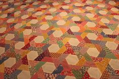 Twisted Hexagon quilt by Buttontree Lane, via Flickr