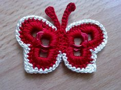 Crochet butterfly made around aluminum pull tabs off of soda pop cans Soda Tab Crafts, Can Tab Crafts, Crochet Crafts, Yarn Crafts, Crochet Projects, Diy Crochet, Crochet Butterfly, Crochet Flowers, Pop Top Crochet