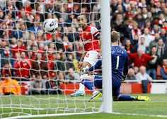 Theo Walcott scores the first goal for Arsenal against Manchester United in the second minute of the match.