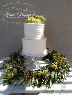 simple and elegant buttercream wedding cake with greenery #simpleelegantwedding #classicbuttercream #greenery