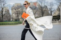 Streetstyle: Elina Halimi clutching the classic by Céline in tangerine during Fashion Week