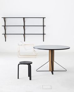 The 'Kaari' circular table and shelving on the back wall shownwith Aalto's 'Paimio' chair and 'model 60' stool.  Photo: Bouroullec Studio.
