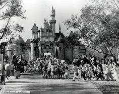 Children sprint across a drawbridge and into a castle that marks the entrance to Fantasyland at the opening of Walt Disney's Disneyland in Anaheim, Calif. Fantasyland had been closed until late in the day Lego Batman, Disney Parks, Walt Disney World, Disney Fun, Disney Theme, Disney Stuff, Disney Magic, Disneylândia Vintage, Disneyland Opening Day