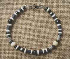 Men's black and white beaded bracelet is designed with onyx gemstone and complimentary beads. This bracelet is designed for men with a natural look suitable for