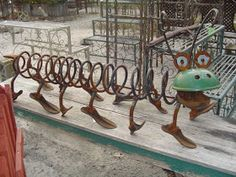 "Recycled metal art - photo by magpie cottage blog;  The blogger says, ""i just cant believe i sold this...it's by my favorite junk artist."" But the blogger doesn't say who the artist is!"