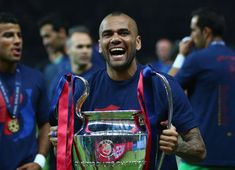Daniel Alves of Barcelona celebrates with the trophy after the UEFA Champions League Final between Juventus and FC Barcelona at Olympiastadion on June 6, 2015 in Berlin, Germany.