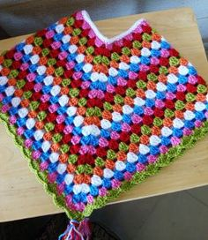 Candy Crush Crochet Poncho -- This would be super easy to adapt in color and size.  A girl could make one for her doll while her mom made one for her.  :)