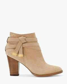 """Uplifted by a chunky stacked heel, we have deemed this moto-inspired ankle boot a fall essential. Our neutral-color design features precisely wrapped straps, accented by gleaming goldtone hardware.   Suede moto ankle boots  Approx. 3"""" heel  Suede and manmade materials; synthetic sole  Imported"""