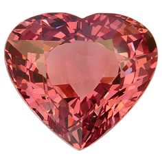 Malaia Garnet Heart, 11.22 cts.  Malaia is name given to garnets orange to pinkish orange to red in color which do not match the color and gemological properties of any of the other more well known varieties of garnet.