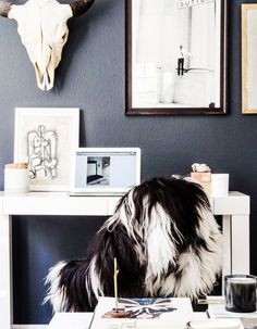 Black and white workspace with leaning art
