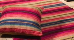 Three sizes available! Gorgeous Andaman wool rug – with matching cushion covers. Bright pink with multi coloured stripes. A fair trade product from India.
