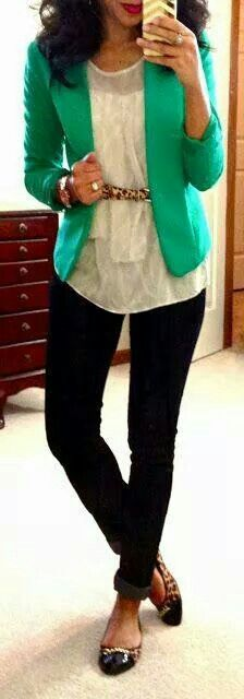 Green blazer with white lace blouse and black pants