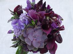 Purple wedding bouquet with succulents, callas, lady slipper, orchids. Flleurs de France www.fleursfrance.com