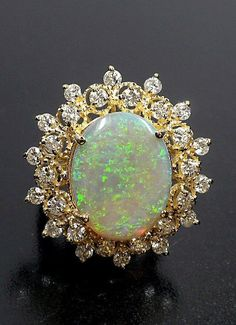 Opal..so many water drops trapped to make the stone valuable and worth of admiration.