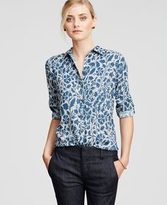 Dressed in an alluring floral print, we love how you can wear the button tab sleeves rolled up or down for two looks in one.
