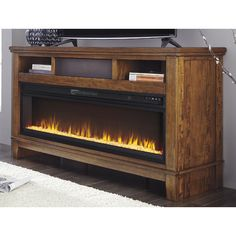 Found it at Wayfair - Hylan TV Stand with Electric Fireplace Electric Fireplace Tv Stand, Tv Stand With Fireplace, Electric Fireplaces, Fireplace Wall, Fireplace Ideas, Motorized Tv Lift, Television Console, Plasma Tv Stands, Swivel Tv Stand