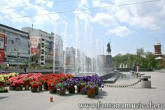 flowers festival Craiova 9 - From May 30 to June 2nd the entire Craiova City Center became the host for the Craiova Flowers Festival 2008. All the area near the musical fountain was inundated with flowers and decorative objects. Hosted by www.iCraiova.com Flower Festival, Decorative Objects, Fountain, Sidewalk, June, City, Flowers, Side Walkway, Water Fountains