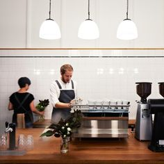 Designed by Hearth Studio, Market Lane Coffee in Melbourne is a space informed by the incredible heritage of the corner stall. Previously a pharmacy for 40 years, the original 1920s heritage features of the store have been preserved and showcased. Suspended above the central brewing island, elegant 1950s Czech opaline pedants from Skinflint compliment the beautiful simplicity of the retail space.