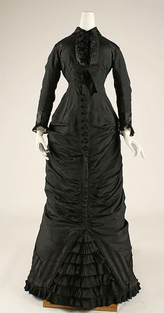 Afternoon dress 1876-77. The cuirass silhouette when the bustle disappeared, then reappeared again c. 1882-83.