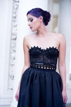 Steal the spotlight in a handmade black-lace corset.