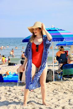 Beach coverup, red one-piece swimsuit. Beach outfit.