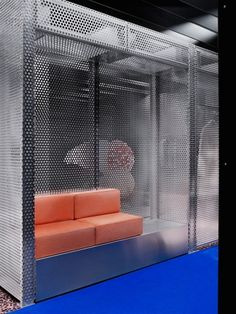 Perforated walls play with semi-transparency and help define various zones.