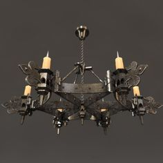 He likes this gothic chandelier for above the kitchen table.