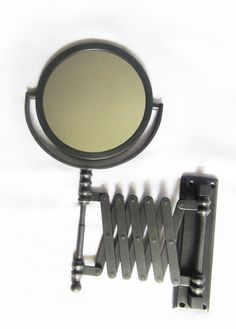 oil rubbed bronze extendable mirror - photo by apartmentf15