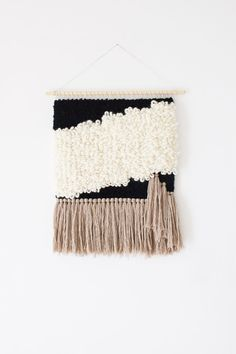 MADE TO ORDER This is a made to order item, please expect approximately 2 weeks for your order to be produced, packaged and prepared for shipment.  This woven wall hanging is a true eye catcher and will be perfect as your home wall decor, whether it be hung. The color palette is well balanced with soft tones of ivory, off white, beige and black. This piece is woven with wool, wool and alpaca and wool with silk. Colours are true but please be aware that there may be differences between my…