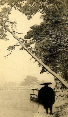 """katombo:    MAN IN GRASS COAT UNDER A LEANING SNOW-PINE (by Okinawa Soba)  THIS IMAGE is one of several examples of a largely ignored facet of Old  Japanese Photography — a genre called """"TAISHO ART"""" or """"TAISHO PICTORIAL  PHOTOGRAPHY"""". The pictorialism movement in Japan reached its peak  during the reign of EMPEROR TAISHO (1912-26), thus the name attached to  the genre. See the extended comments at the set link for PICTORIALISM IN  OLD JAPAN just to the right of this picture."""
