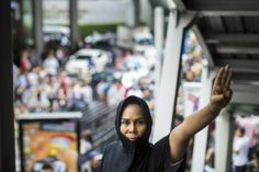 """Hunger Games Salute Becomes a Real Sign of Dissent in 'Tyrannical' Thailand [TIME Magazine]  """"The fact that the [junta] is closing down sections of the city to chase a handful of protesters reveals a totalitarian mind-set that discounts respect for human rights as a hindrance, and sees youthful defiance as the enemy,"""" he said by email.""""  READ MORE: http://time.com/2816496/hunger-games-salute-becomes-a-real-sign-of-dissent-in-tyrannical-thailand/"""