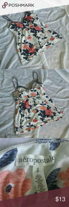 Aeropostale Floral Tank Top Camisole Size Small This top is from Aeropostale and is lightweight - perfect for warm weather! It has adjutable straps and three small buttons in the front. It is white with navy blue leaves and pink/coral flowers.  Brand: Aeropostale  Size: Small Color: White with navy blue and pink/coral Condition: Good. No tears or rips. Light pilling in armpit areas. Aeropostale Tops Tank Tops