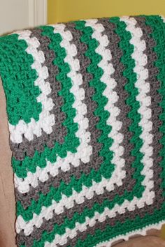 I recently made this baby blanket for a friend's new bundle of joy. Her new baby boy's nursery was decorated in green and gray, so I though...